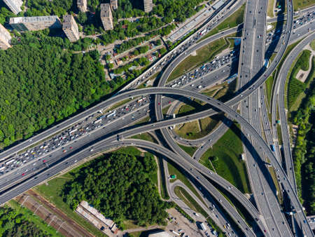 Busy multilevel junction in summer in outskirts Stock Photo