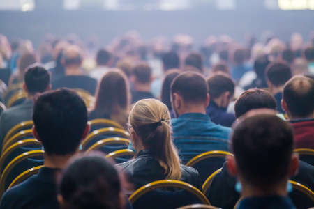 Unrecognizable people sitting in auditorium Stockfoto