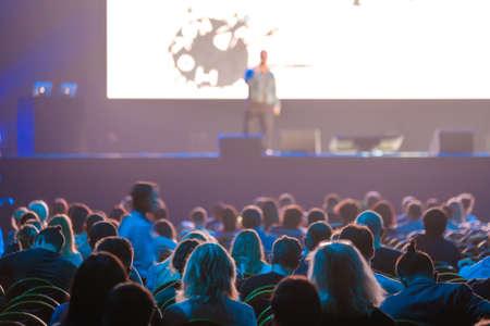 Audience sitting near illuminated stage