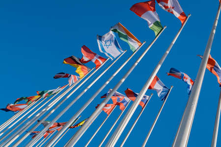 Different flags fluttering on flagpoles