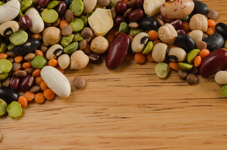 bean family: legumes on wood, close-up, background