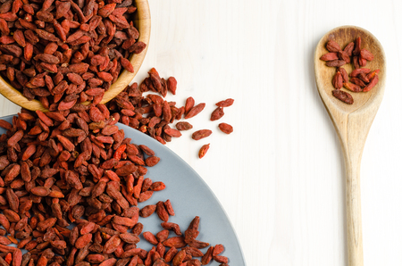 bath supplement: Goji berry dried in a dish with spoon closeup background Stock Photo