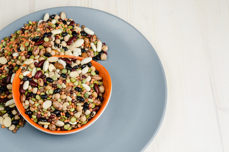bean family: legumes in a dish on table, close up, background