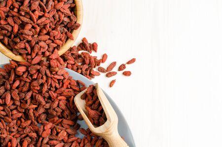 goji berry: Goji berry dried, with spoon, closeup background
