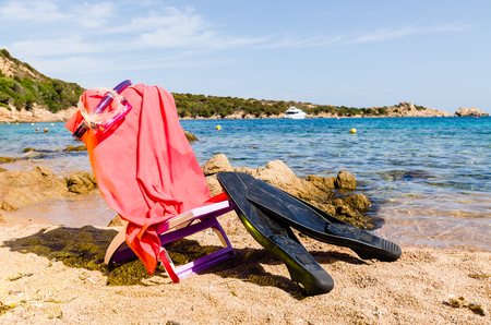 flipper: deckchair with diving mask and flipper, on the beach, sunny day