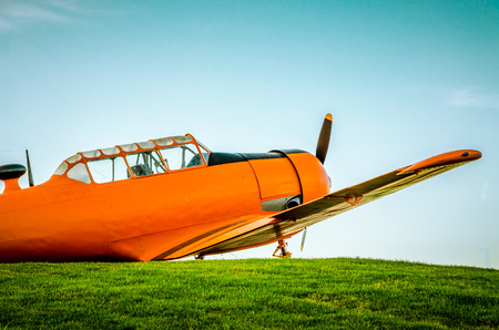 texan: Adventure in the sky, Old airplane, orange, North American T-6G Texan Stock Photo