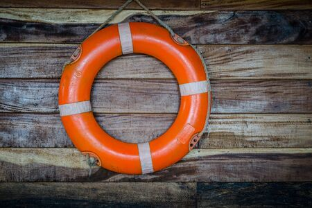 buoy: orange life buoy, on wood
