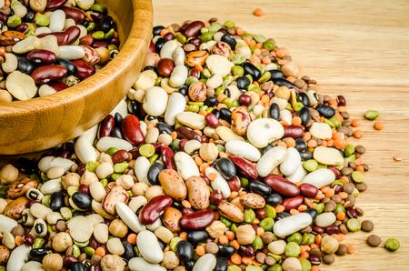 bean family: legumes on wood, closeup, background Stock Photo