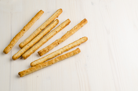 rustic breadsticks on wood table, close up, background