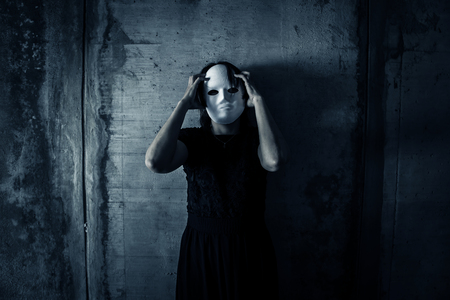 Scary ghost woman wearing white mask in Haunted House, Horror background