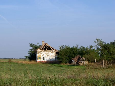 abandoned farmhouse abandoned farmhouse: Abandoned dilapidated farmhouse on the edge of the field.