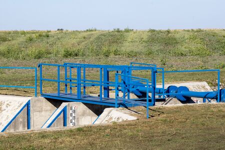The railing and sluice regulate the water.