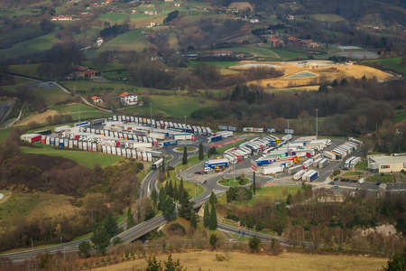 View from the mountain to the crowded parking of trucks in Spain Stock Photo