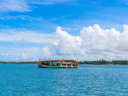 trawler net: Four fishing boats in the sea with blue sky background