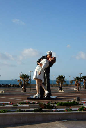 parting the sea: The sculpture of kiss of the seaman and the girl in the harbor