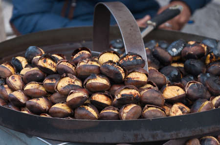 tots: Closeup of some roasted chestnuts Stock Photo