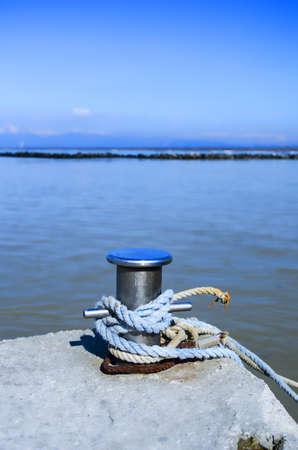 Bollard on the dock of the river Arno  Standard-Bild
