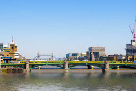 southwark: View of Southwark Bridge against the backdrop of Tower Bridge and a beautiful sky.