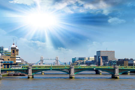 southwark: View of Southwark Bridge against the backdrop of Tower Bridge and a beautiful sky