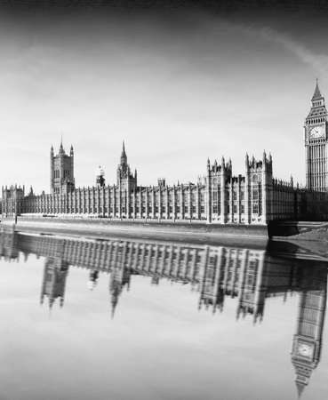 Westminster palace and Big Ben reflection on the Thames  photo