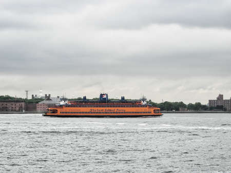 staten: MANHATTAN, NY - JUL 13: The Staten Island Ferry a municipal service since 1905 (it began in 1817), currently carries over 21 million passengers annually on the 5.2-mile (8.4 km) run. NYC July 13, 2103.
