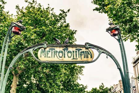 Old metro sign in Paris.
