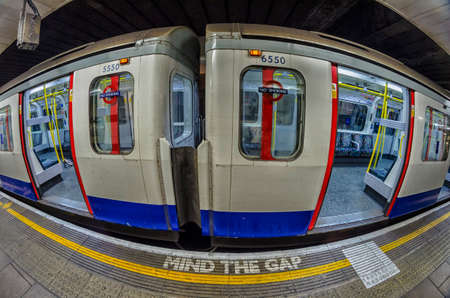 London tube platform edge. Painted warning on the floor.