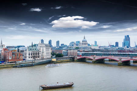 London skyline with background St. Paul Cathedral. photo