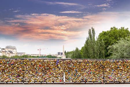 Padlocks on bridge in Paris.
