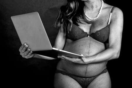 Pregnant woman technology. photo