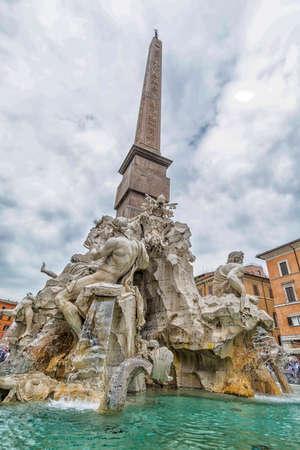 obelisk stone: Fountain of the Four Rivers, Rome. Stock Photo