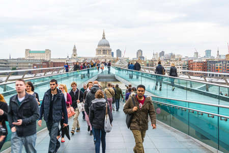 saint pauls cathedral: LONDON - AUG 31, 2014: St. Pauls cathedral from the millenium bridge Editorial