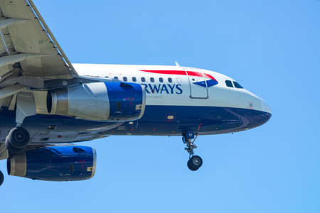 british weather: PISA, ITALY - AUGUST 25, 2015: British Airways Airbus A320 passenger plane taking off from Pisa International Airport, August 25, 2015 in Pisa. Heavily overcast weather with some sun.