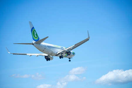 aircraft landing: ITALY - FLORENCE SEPTEMBER 02: Transavia in fleet aircraft landing at the airport of Peretola, 02 Septembre 2015, Italy. Peretola airport is the second airport in Tuscany.