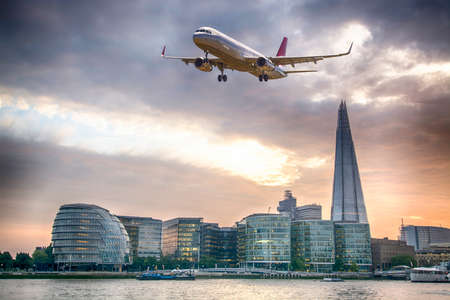 Plane over London. Stock Photo