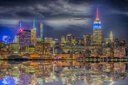 night views: Manhattan skyline by night. Stock Photo