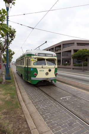 mover: San Francisco Cable Trolley Car moves through the street California people mover transportation Editorial