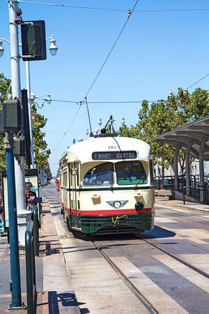 streetcar: San Francisco vintage f- streetcar, train, tram or muni cable trolley car traveling down the Embarcadero on a sunny day. Originally a Mexico City car built in 1946 trolley. Editorial