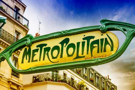 france station: Famous Art Nouveau sign for the Metropolitain underground system, Paris. Stock Photo