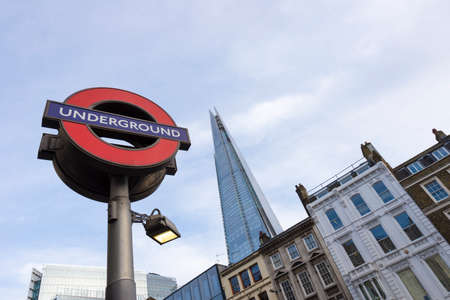 LONDON, UK - JEN 16: A London Underground station sign shown with the Shard de-focused in the background shown on Jenuary 16, 2015 in London, UK. Editorial
