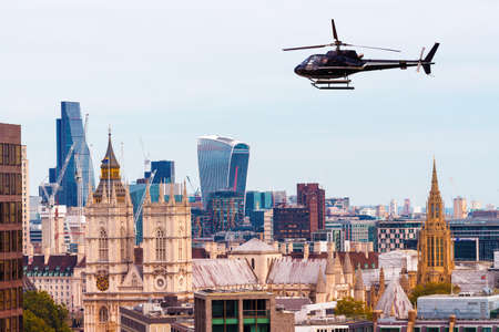 Helicopter over London skyline, old and new.