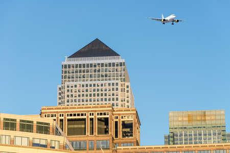 canary wharf: Airplane over Canary Wharf. Stock Photo