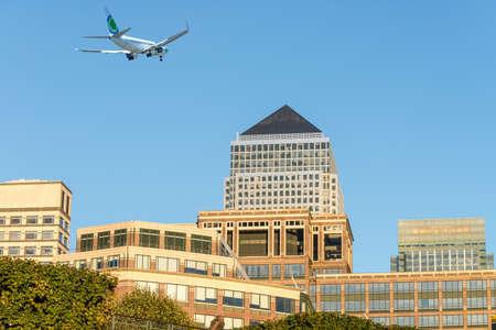 wharf: Airplane over Canary Wharf. Stock Photo