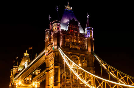 Details of Tower Bridge by night.