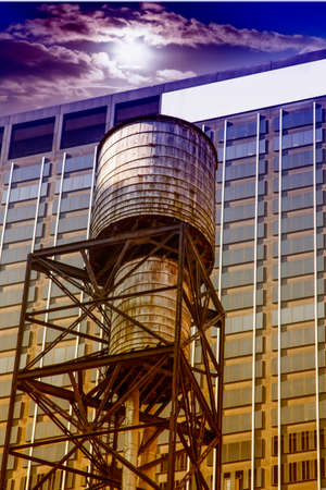 Tipcal water tank in Manhattan. Stock Photo