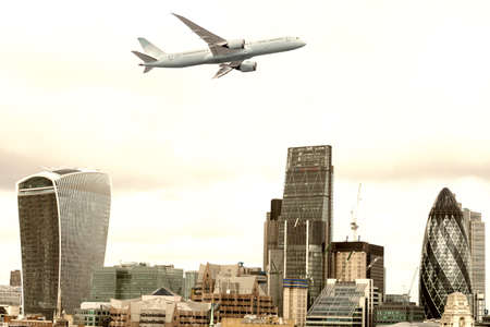 Airplane over new London skyline. Stock Photo