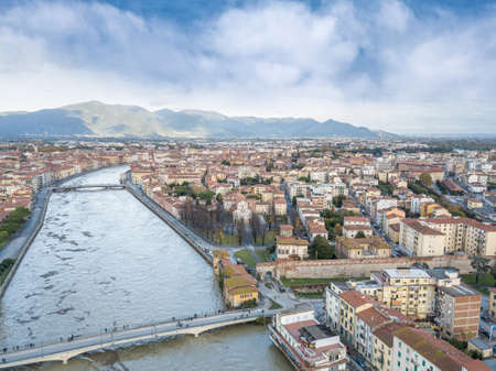 Aerial view of the Arno river during flood, Pisa, Italy.