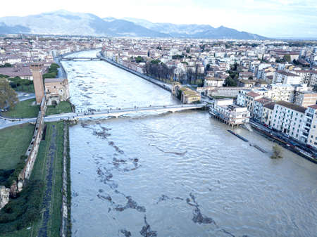 Aerial view of Pisa and the Arno river during a flood, Tuscany, Italy.