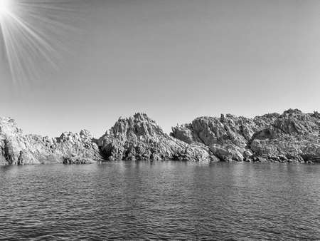 Rocky coast and crystal clear sea, Sardinia, view from boat.