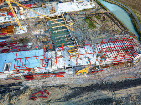 Aerial view of a construction site with heavy machinery for material lifting. Stock fotó